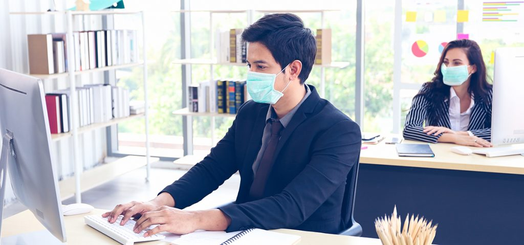 Office workers wearing masks