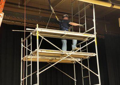 Sprinkler Fitter Foreman setting up scaffolding